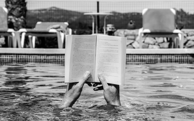 The Creative - 2018 EyeEm Awards The Still Life Photographer - 2018 EyeEm Awards Book Day Full Length Human Body Part Human Hand Leisure Activity Lifestyles Low Section Men Nature One Person Outdoors Reading Real People Rear View Swimming Pool Tranquility Underwater Vacations Water Sommergefühle An Eye For Travel Visual Creativity Summer Sports Be Brave A New Perspective On Life Analogue Sound