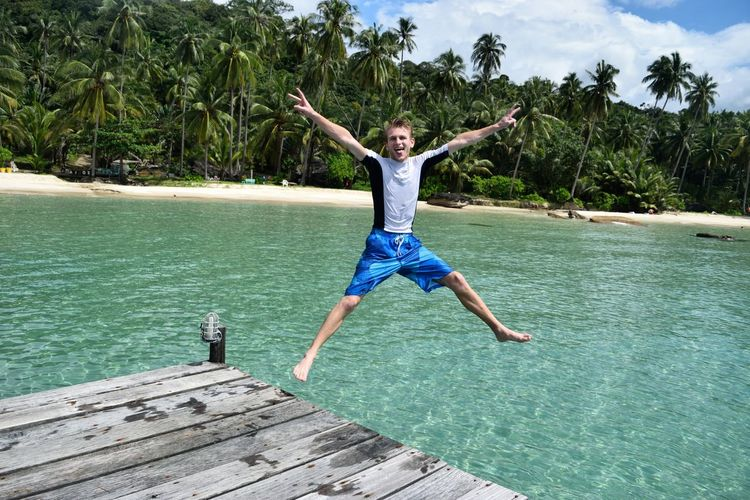 Koh Kood Thailand Arms Outstretched Arms Raised Carefree Day Enjoyment Excitement Full Length Fun Happiness Human Arm Human Body Part Jumping Leisure Activity Limb Mid-air Motion Outdoors Pier Summer Tropical Vacations Vitality Water