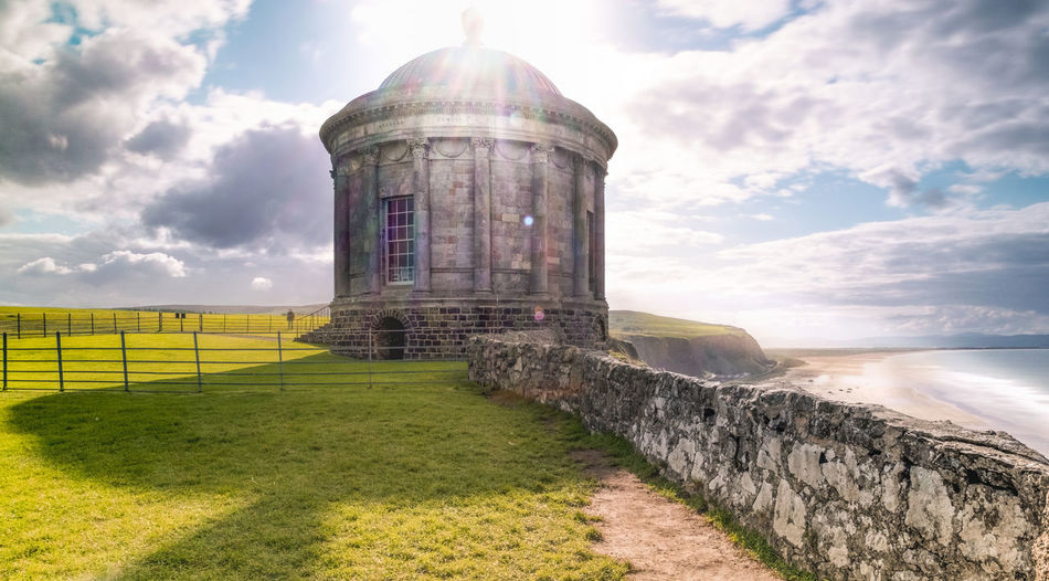 A divine light for an amazing landscape Lanscape_Collection  Northern Ireland Architecture Building Exterior Built Structure Cloud - Sky Day Grass History Land Landscape_photography Mussenden Temple Nature No People Sky Sunlight Temple Temple Architecture Travel Travel Desinations Travel Destinations Capture Tomorrow