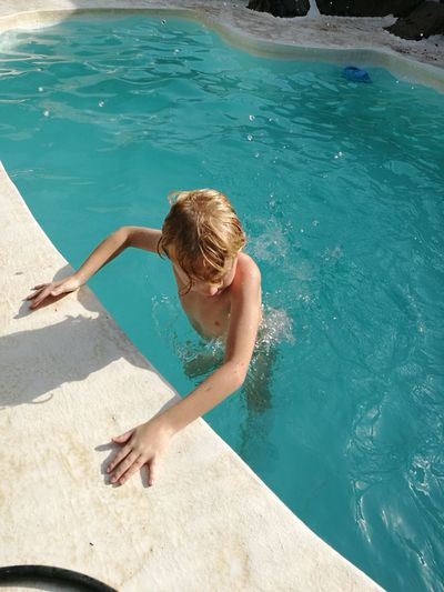 EyeEm Selects Water Swimming Pool Sea Beach Full Length Swimming Summer Child High Angle View Shirtless Poolside Sunbathing Beach Holiday