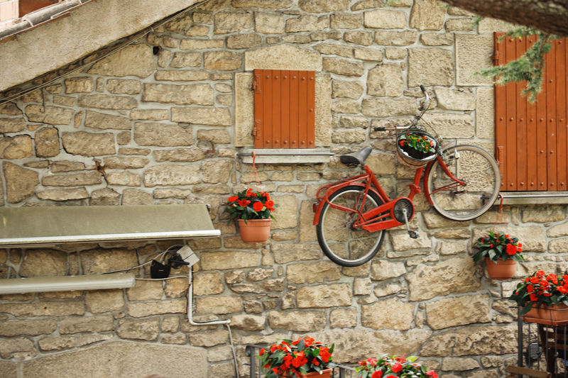 Architecture Building Exterior Bicycle Built Structure Transportation Flower Stone Wall Wall - Building Feature Building Wall Day Plant Flowering Plant No People Window Potted Plant Outdoors Mode Of Transportation House Entrance Brick Flower Pot Italy Bike Bicycle Rack Hanging Decoration Decor Decorative San Marino Travel Travel Photography Traveling Destination Vacations