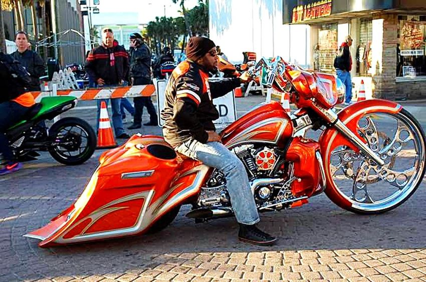 Motorcycle Biker Outdoors Daytona Beach Bike Week 2017 EyeEmNewHere Crowd People Bicycle Transportation Riding Mode Of Transport Cycling Full Length Land Vehicle City Life Day City Adults Only Adult Building Exterior One Person One Man Only Only Men EyeEmDiversity