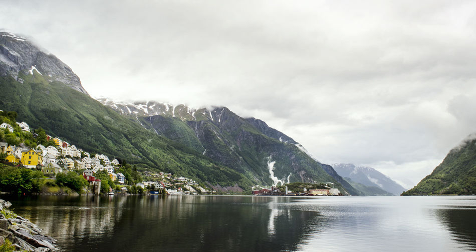 Odda, Norway Norway Norway🇳🇴 Beauty In Nature Building Cloud - Sky Day Fjord Hardanger Hardangerfjorden Lake Mountain Mountain Range Nature No People Odda Outdoors Range Reflection Scenics Sky Tranquil Scene Tranquility Water Waterfall Waterfront