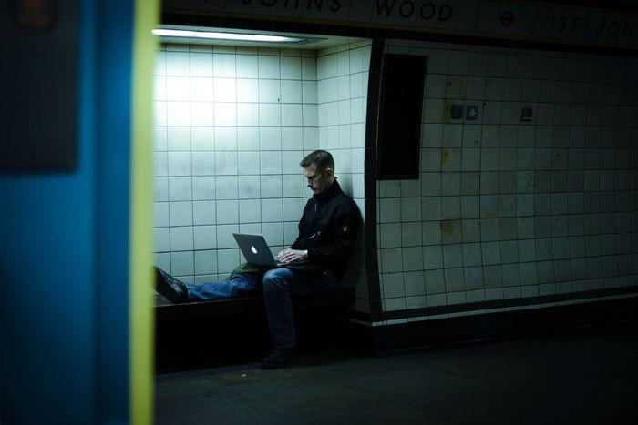 FULL LENGTH OF MAN USING MOBILE PHONE IN OFFICE