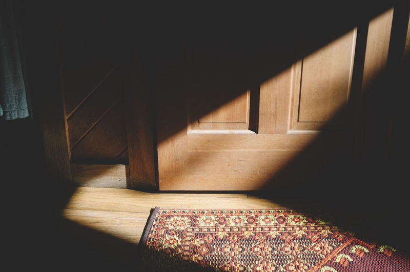 Sunlight Falling On Doormat By Door At Home