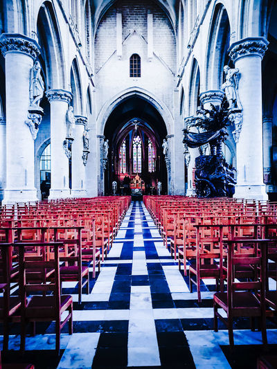 An empty church Empty Church Cathedral Abandoned Places Copy Space Centered Centered Perspective Parish Churchgoers Ecclesiastical Architecture. Nave Church Tax Silence Quiet Place Of Worship Spirituality Pew Religion Arch Architecture Interior Historic Crucifix Cross Altar Christianity Catholicism Cross Shape Religious Symbol Jesus Christ