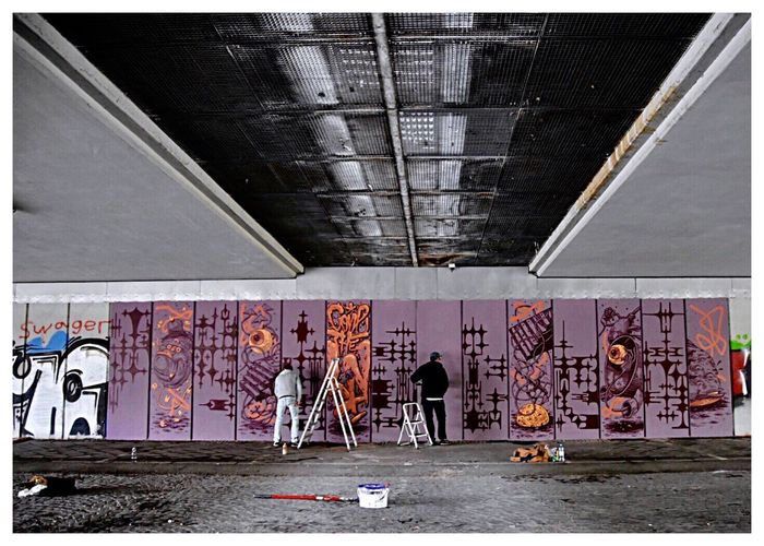 Art in work 🎭🎨✨ Art In Work EyeEm Street Photography Graffiti Architecture Built Structure Text Wall - Building Feature Day City Transportation Building Exterior Communication Creativity Wall Real People Street Art Lifestyles Outdoors One Person Art And Craft Transfer Print