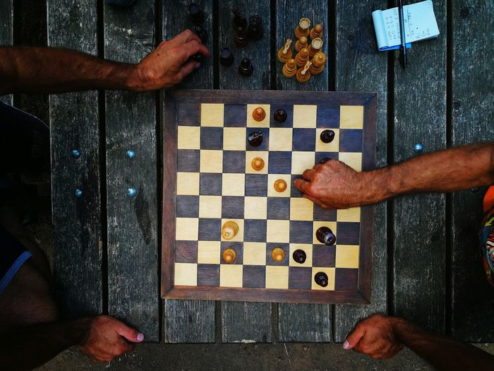 High angle view of men playing on table