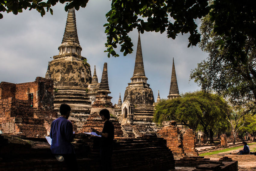 Ayutthaya Ruins Ancient Ancient Civilization Architecture Building Exterior Built Structure Day History Men Nature Old Ruin Outdoors People Place Of Worship Real People Religion Sky Spirituality Travel Destinations Tree Two People