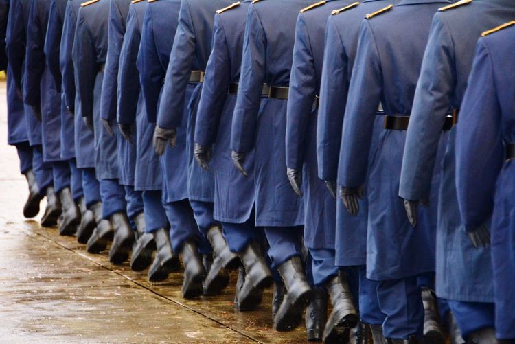 Soldiers Walking On Street In A Row