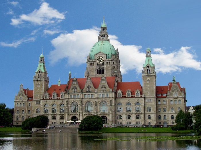 Scenic view of town hall building by lake