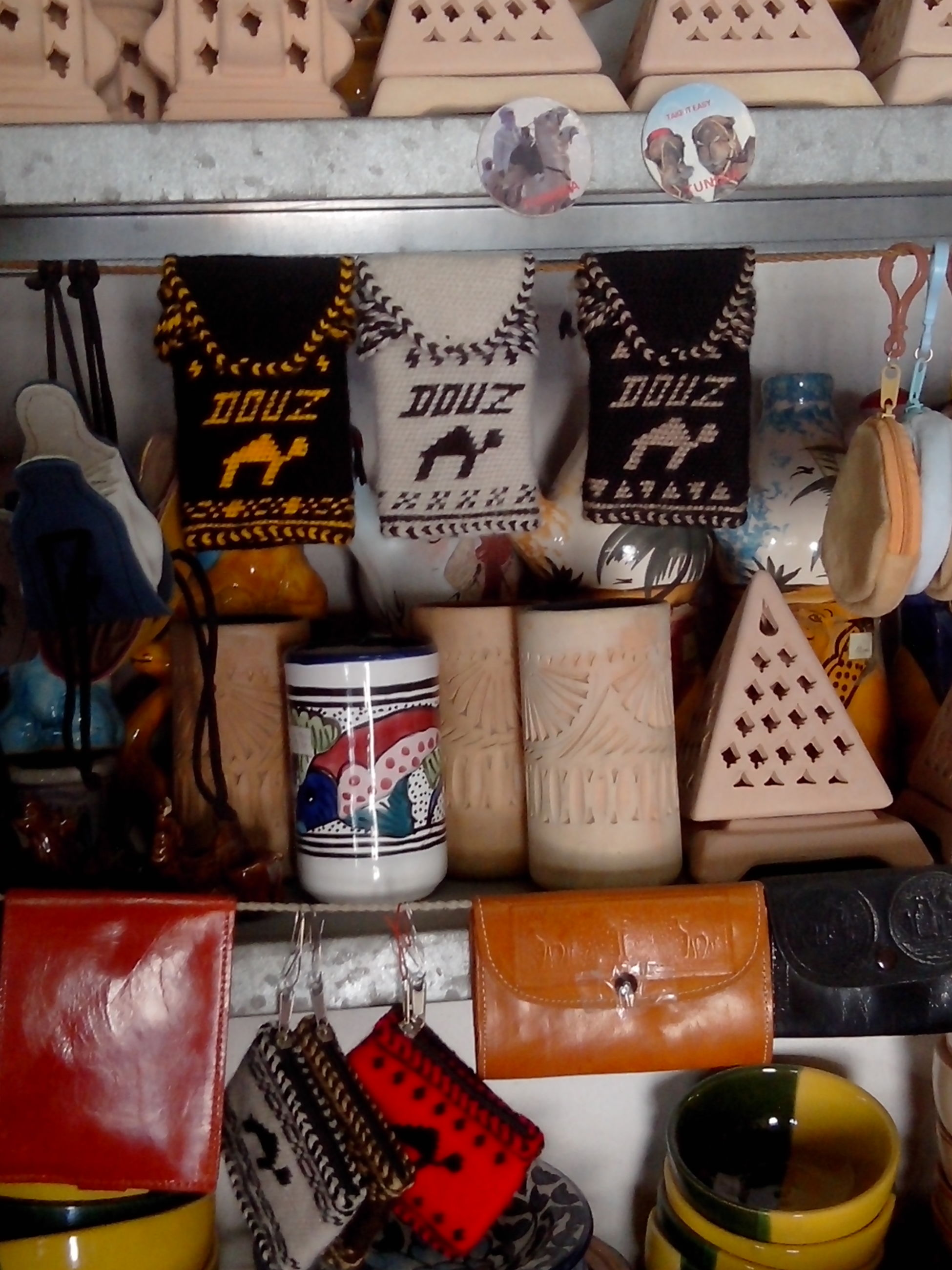 indoors, variation, choice, for sale, still life, retail, large group of objects, arrangement, abundance, table, store, display, shelf, food and drink, in a row, order, collection, book, text, market stall