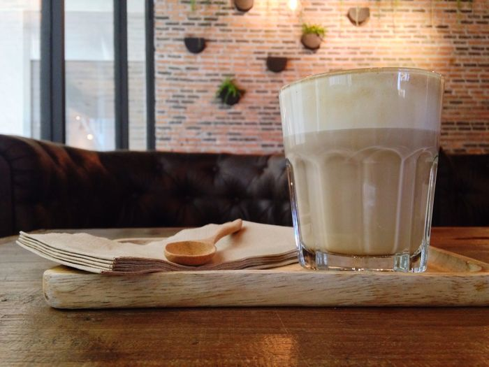 Coffee In Drinking Glass On Wooden Table