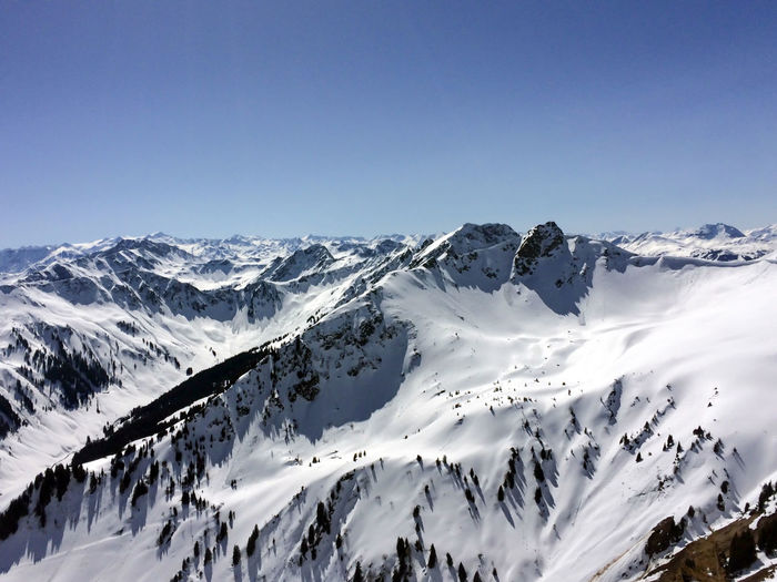 Winter snow covered mountain peaks in austrian alps.