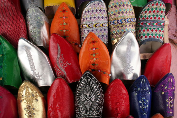 Close-up of multi colored shoes displayed for sale
