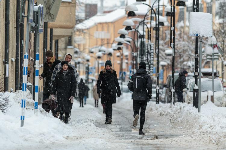 People walking on street in winter