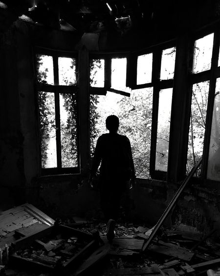 I cheated myself this year Indoors  Silhouette Window People One Person Full Length Blackandwhite Black And White Blackandwhite Photography Black Background Black And White Photography Blackandwhitephotography Shadow Shadows & Lights Abandoned Abandoned Places Lost Lostplaces Light Light And Shadow Close Up Focus On Foreground Focus Point Of View Human Hand