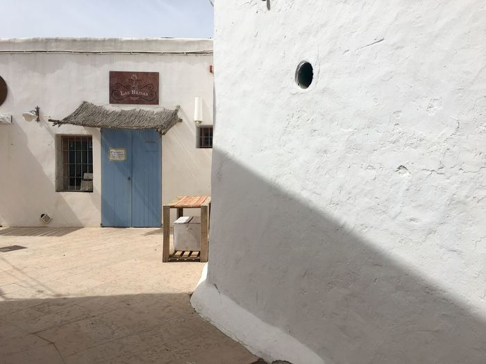 Real lifestyle EyeEm Selects Architecture Built Structure Building Exterior Sunlight Door Inner Power White Color Public Building Window House Sunny Closed Outdoors Wall - Building Feature Nature Shadow No People Day Building Entrance