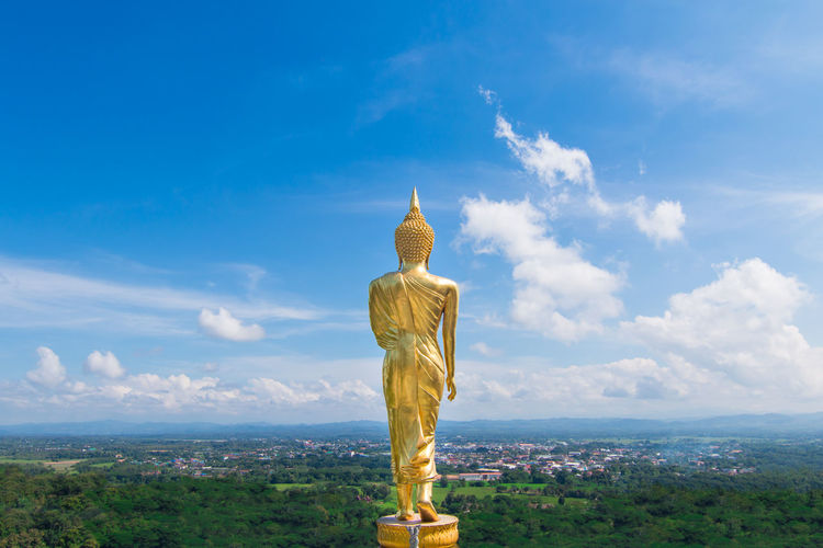 The back of golden Buddha at Khao Noi temple, Nan, Thailand Clear Sky Budha Budism Gold Top Back Sky Statue Sculpture Cloud - Sky Religion Belief Spirituality Day Architecture No People Landscape Outdoors Nature Built Structure EyeEmNewHere