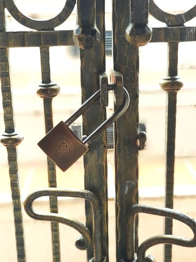 Close-up of padlock hanging on railing
