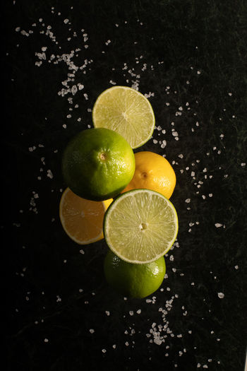 Close-up of fruits in water against black background