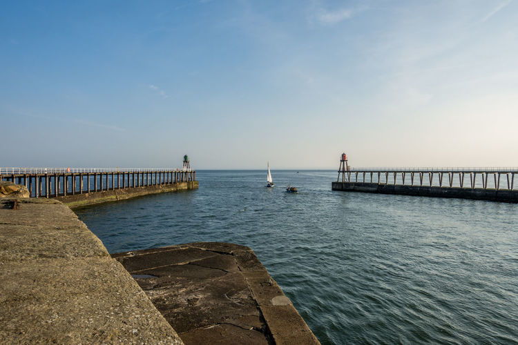 Whitby Whitby Harbour Whitby View Whitby North Yorkshire North Yorkshire North Yorkshire Coast Seaside Seaside Town Tourist Destination Coast Coastline Whitby Pier Day No People Outdoors Pier Sea Sky Water Beauty In Nature Horizon Tranquil Scene Tranquility Built Structure Architecture