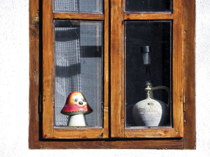 Close-up of toy on window