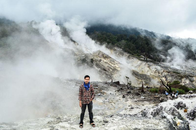 Full length of man standing at kawah ratu in taman nasional gunung halimun salak