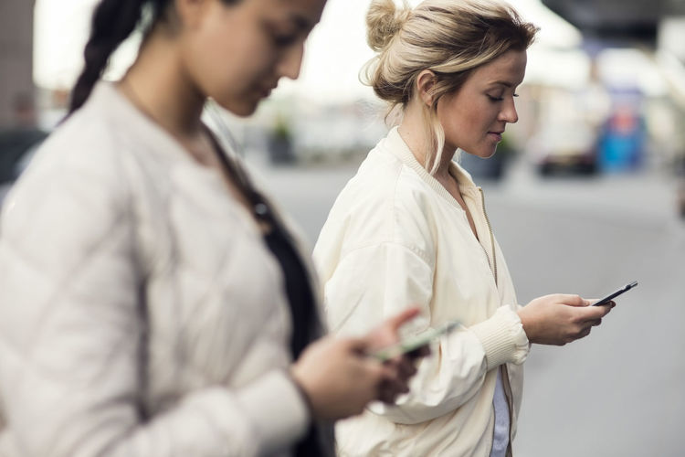 Woman standing on mobile phone