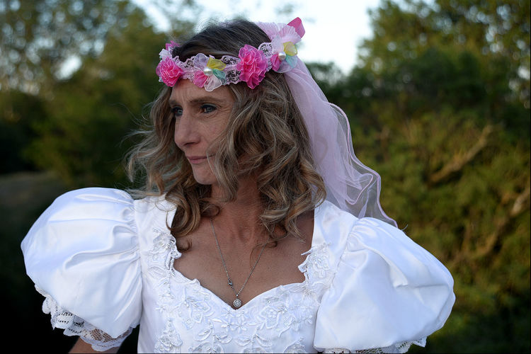 Mature bride standing outdoors