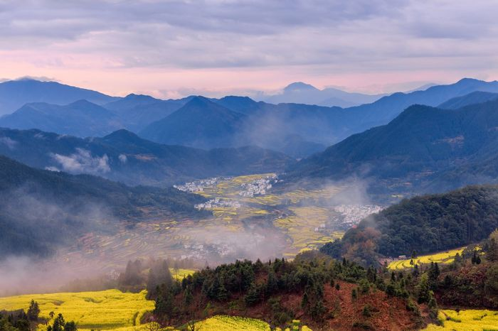 Mountain Mountain Range Nature Tree Landscape Tranquil Scene Dusk Beauty In Nature No People Outdoors Scenics Illuminated Cloud - Sky Sky Day China Landscape_Collection Paint The Town Yellow
