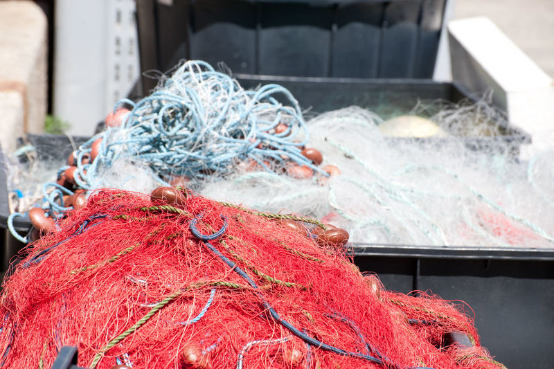 Fishing nets piled up in boxes