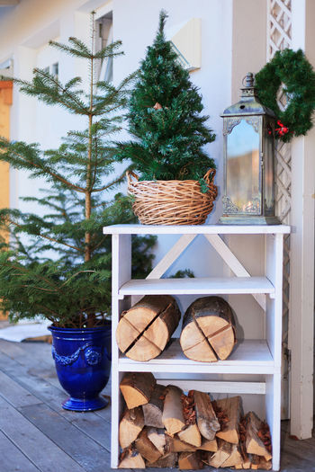 Christmas, Christmas time, Winter, deco, decoration, exterior, Christmas decoration, Christmas tree, lantern, candle, Firewood, Shelf, Sweden fire, romance, humor, Season, Holidays, door wreath, tree, wood, Christmas tree stands, fire, candle light Candle Christmas Time Exterior Holidays Humor Lantern Romance Süden Fire Tree Winter Candle Light Christmas Christmas Decoration Christmas Tree Stands Close-up Day Decoration Door Wreath Déco Firewood Indoors  No People Season  Shelf Tree
