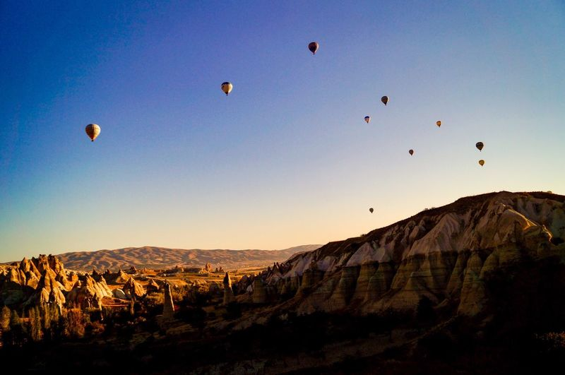 Sky Flying Hot Air Balloon Mountain Nature Environment Mid-air Scenics - Nature Beauty In Nature Balloon Landscape Travel Destinations Silhouette Sunset Tranquil Scene EyeEmNewHere