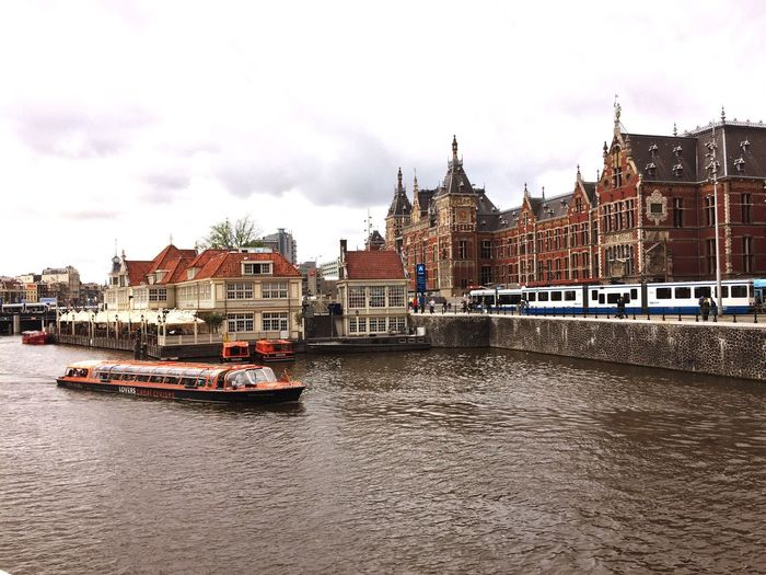 Cruise ship on canal in amsterdam