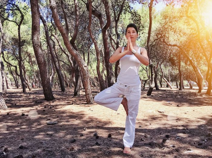 When everything starts to bend, you need to stay balanced! Pine Wood Pine Tree Pine Cone Pine Travel Summer Way Of Life Belief White Training Fitness Health Balance Posture Park Park - Man Made Space Healthy Lifestyle Yoga Pose Yogagirl Yoga Leisure Activity Lifestyles Tree Young Women Nature Casual Clothing Beautiful Woman Fashion Sunlight Standing