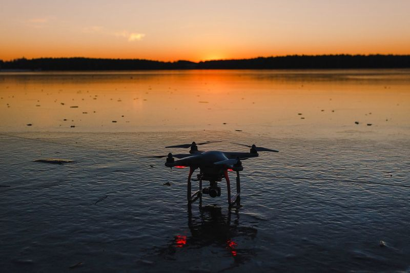 View of drone on lake during sunset