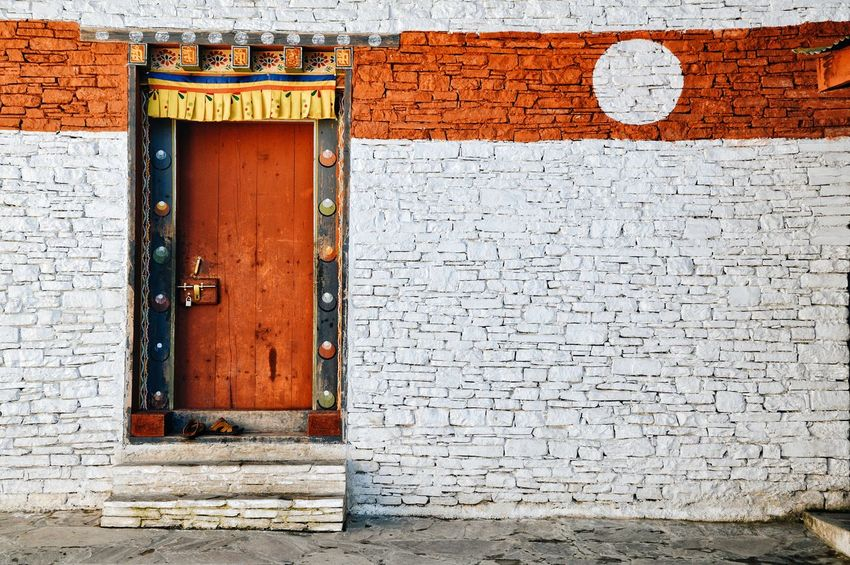 Beautiful things don't ask for attention EyeEm EyeEm Best Shots Bhutandiaries Bhutanese Temple Bhutanese Architecture Bhutanese Culture Façade Monastery Monastery Of Stone #bhutan Textured  Door Close-up Architecture Built Structure Whitewashed Entryway Entrance Wall Closed Door
