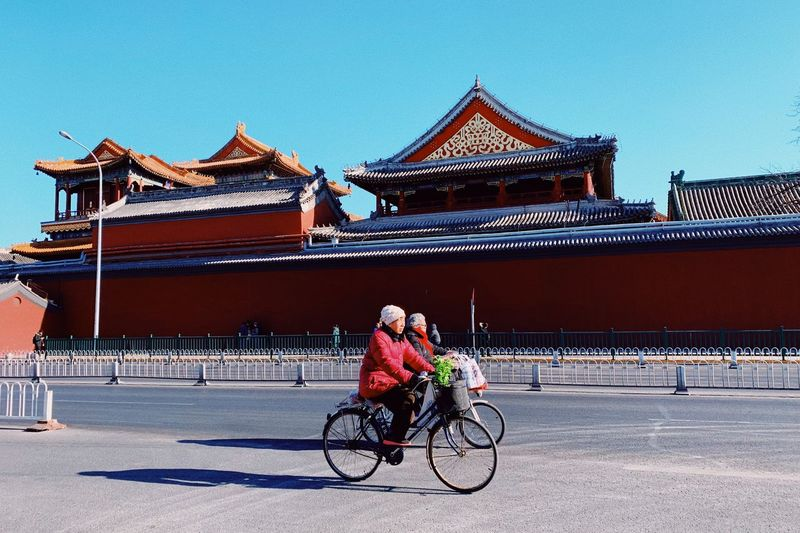 Colorful Dailylife Beijing Sunny PhonePhotography Yonghegong Riding Bike Architecture Built Structure Real People Building Exterior Bicycle Lifestyles