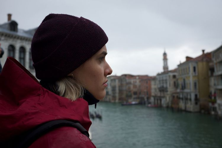 Close-up of woman looking at canal