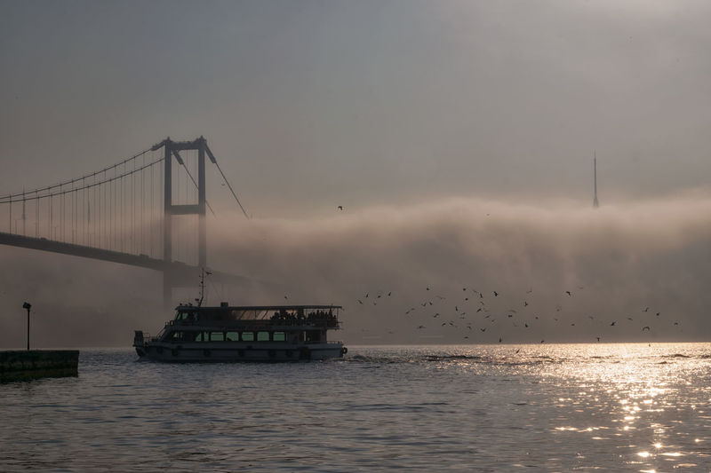Boat and 15 july martyrs in foggy morning istanbul turkey
