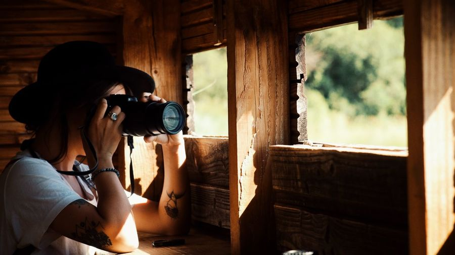Woman photographing through window