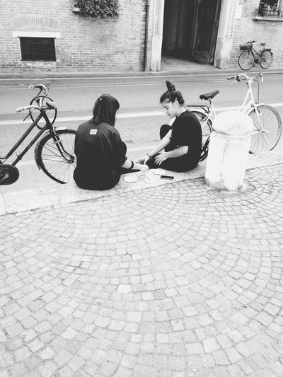 Playing Cards 🍀 Sofiavicchi Sofiavicchiconceptdesign Streetphotography Bnw Street Streetphoto_bw Girls Bycicle Relaxing Game