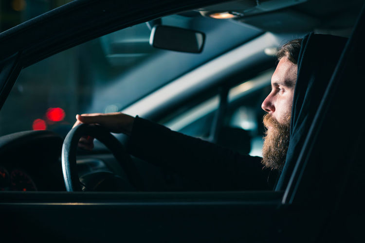 Car Mode Of Transportation Motor Vehicle Transportation One Person Vehicle Interior Driving Steering Wheel Land Vehicle Car Interior Beard Real People Portrait Headshot Men Lifestyles Facial Hair Travel Glass - Material Outdoors