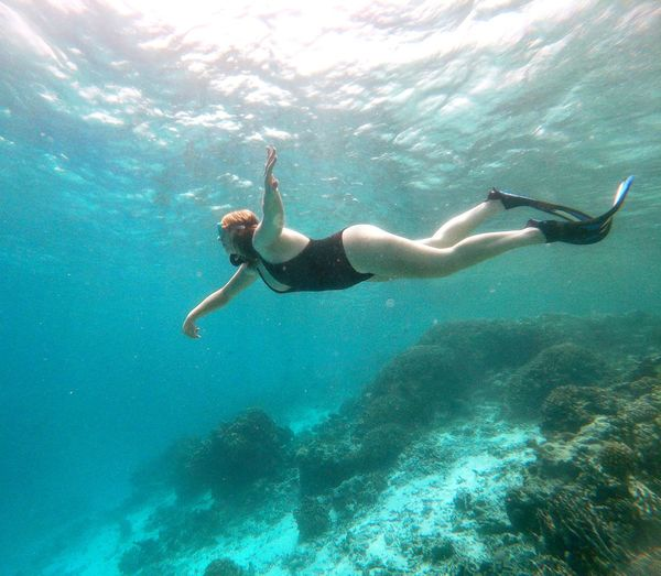 Full length of woman swimming undersea