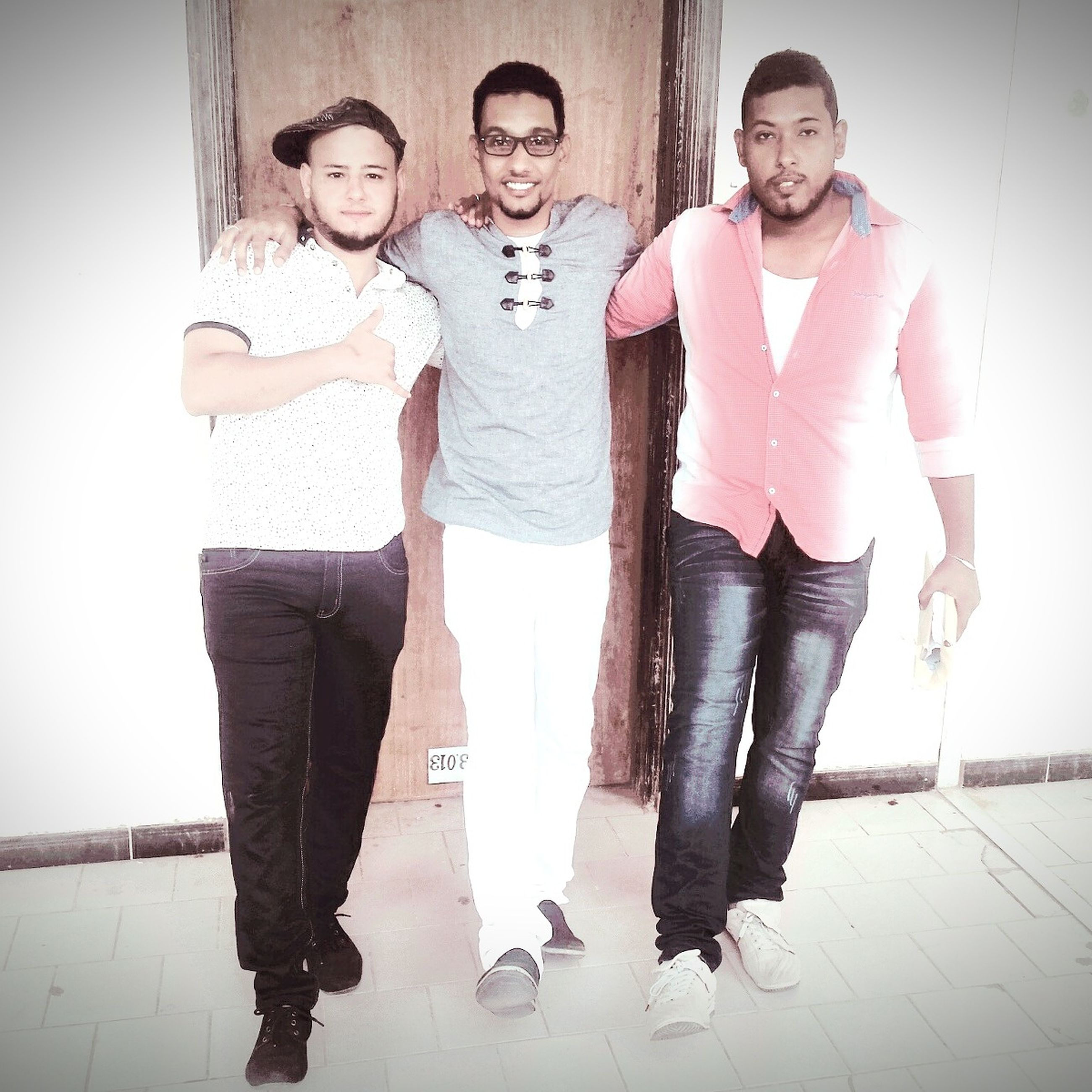 togetherness, bonding, front view, love, friendship, standing, leisure activity, portrait, full length, lifestyles, looking at camera, young adult, casual clothing, person, happiness, smiling, young men, shoe, well-dressed, fashionable, friend