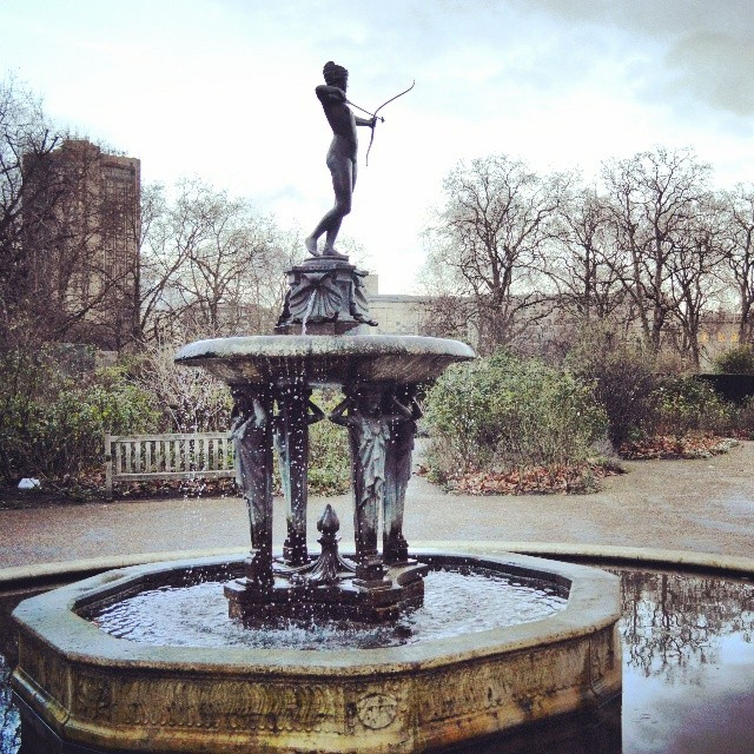 statue, sculpture, human representation, art and craft, art, creativity, fountain, water, tree, animal representation, sky, travel destinations, park - man made space, famous place, pond, monument, built structure, spraying