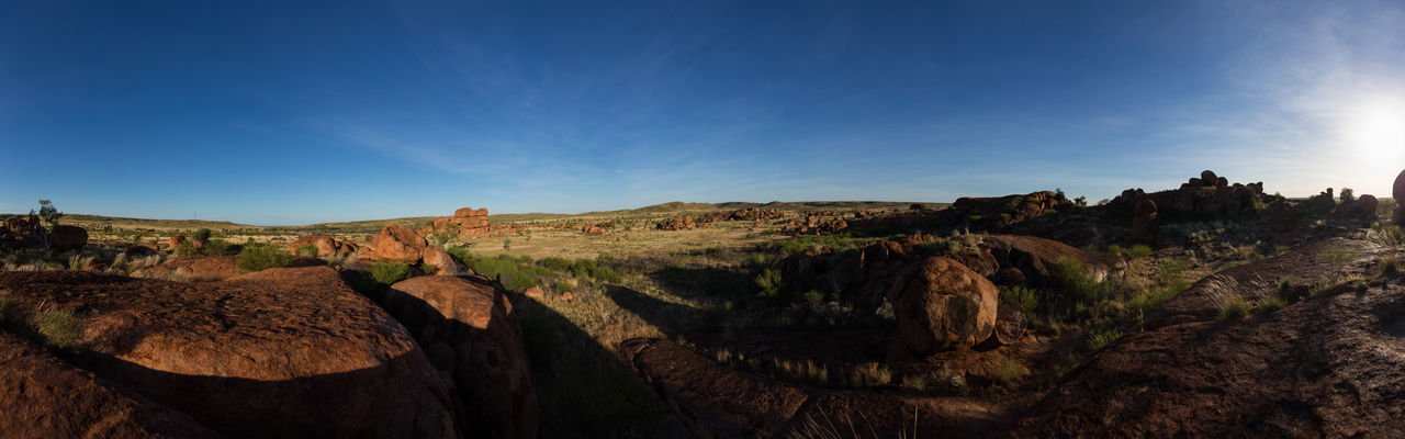 Sunrise at the Devils Marbles in the australian outback. Back Light Backlight Beauty In Nature Blue Sky Bushes Devils Marbles Grass Light Light And Shadow Nature Outback Rock - Object Rock Formation Scenics Stone Stone Material Sunlight Sunrise Tranquil Scene Tranquility