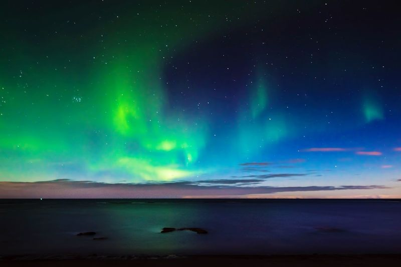 Aurora borealis near Reykjavik Aurora Polaris Nature Night Sky Aurora Borealis Iceland Reykjavik Outdoors Scenics No People Sea Star Field Landscape First Eyeem Photo