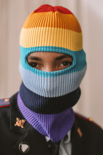 Close-up portrait of young woman wearing knit hat